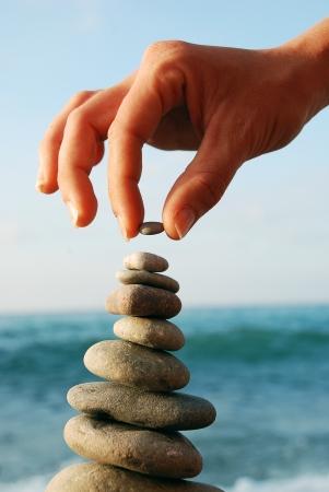 Balanced Stones  Stack of volcanic pebbles on seashore