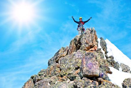 Photo pour A climber on the summit. Extreme sport concept - image libre de droit