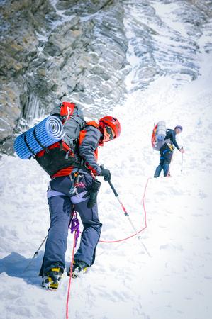 Photo pour Group of climbers reaching the summit. Extreme sport concept - image libre de droit