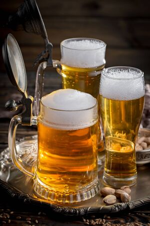 Photo for Light beer in a glass on a table in composition with accessories on an old background - Royalty Free Image