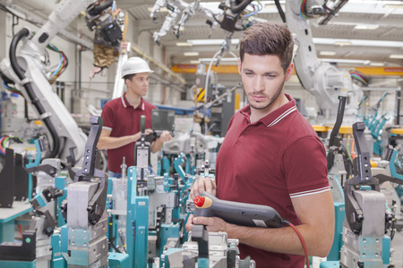 Photo pour two engineers check functionality while commissioning a production line in welding shop - image libre de droit