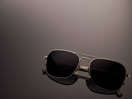 Photo pour Stylish polarized mirrored almost round sunglasses with metal frame and folded ear arms. - image libre de droit