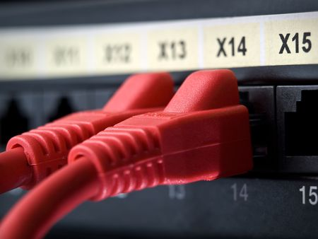 closeup shot of network cables plugged into the switch sockets , shallow DOF