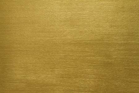 texture of a cement wall covered with gold paint with long strokes
