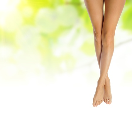 healthy sexy slender female legs over green natural spring background - spa and healthcare conceptの写真素材