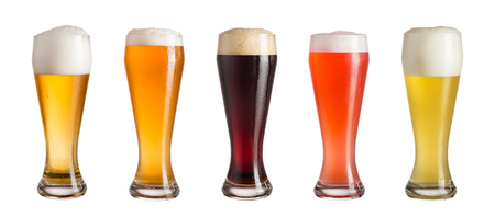 Photo pour Five glasses of different types of cold craft beer isolated on white background - image libre de droit