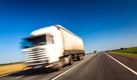 Photo for Delivery truck on highway with speed effect - Royalty Free Image