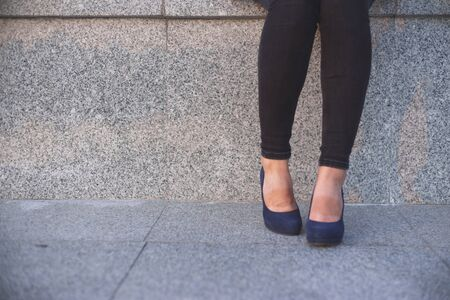 Photo pour Wom?n in high heels having a rest. - image libre de droit