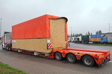 Foto de Oversize load. The truck during a break in travel.  Heavy road transport.  - Imagen libre de derechos