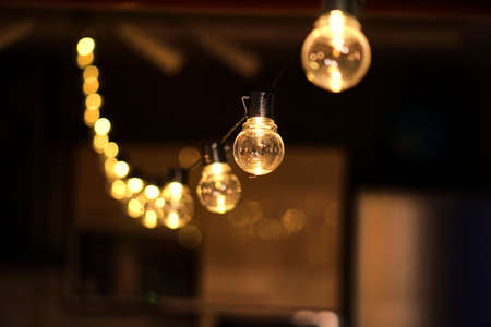 Photo for Christmas garland with golden lamps. Edison for the holiday. Cozy lights. - Royalty Free Image