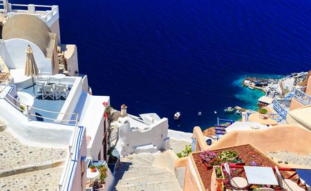 Stairs leading down to the sea. White architecture on Santorini island, Greece. Beautiful view on the sea