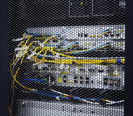 Foto für Looking through honeycomb pattern doors inside modern big data server rack in data center with network servers hardware and storage blades flashing lights - Lizenzfreies Bild