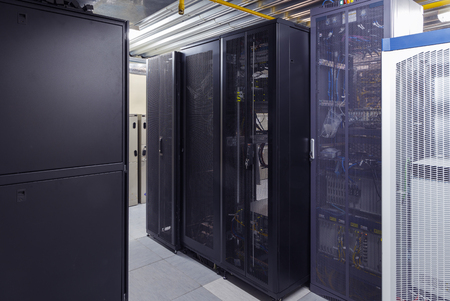 Photo pour Telecommunication servers with supercomputers in datacenter. Modern interior. Data security storage center and global network connection - image libre de droit