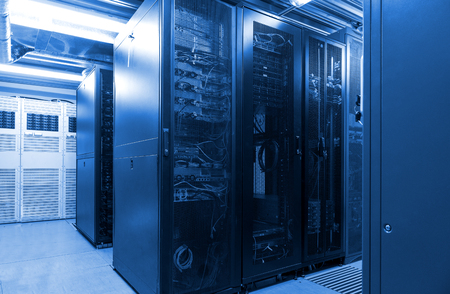 Parallel rows connected servers and internet cable infrastructure in big datacenter