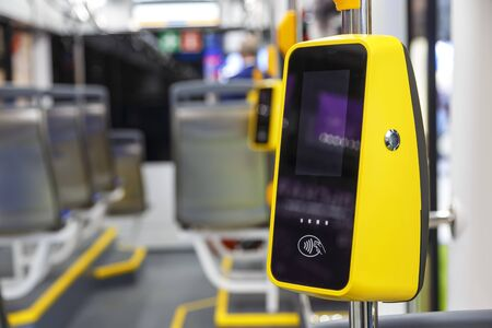 Photo pour Transport POS-terminal. Payment for travel in transport. Validator for applying the ticket. Non-cash transport payment. Contactless travel payment by credit card. Public city passenger transport. - image libre de droit
