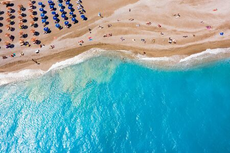 Photo pour famous Ellie beach in Rhodes. sunbeds, beach, sand, waves, top view from the drone. The island of Rhodes Greece - image libre de droit