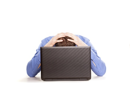 Man frustrated with his laptop computer on white backrgound