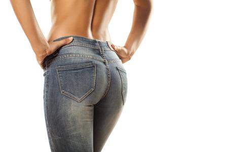 Foto de pretty women  s ass in tight jeans on white background - Imagen libre de derechos