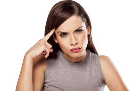 angry pensive woman touching her forehead