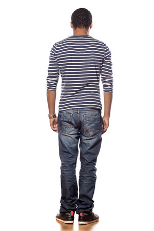 back view of dark-skinned young man in jeans and a blouse