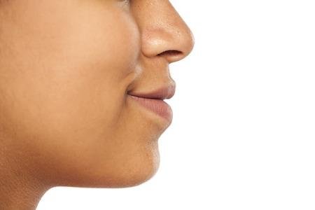 Photo pour closeup of mout without makeup of dark skinned  smiling female - image libre de droit