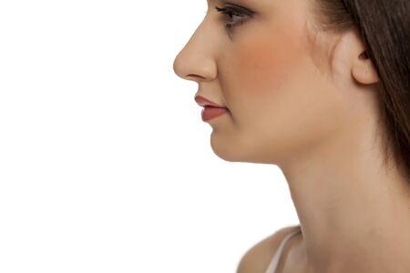 Photo pour Close up of young beautiful woman with makeup on white backgeound - image libre de droit