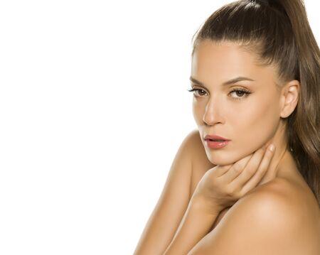 Photo pour Sensual portrait of a young beautiful woman on a white background - image libre de droit