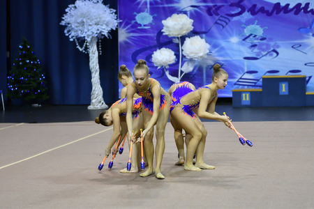 Orenburg, Russia - November 25, 2017 year: girls compete in rhythmic gymnastics perform exercises with sports clubs on the Championship Orenburg region on rhythmic gymnastics Winter melody-2017