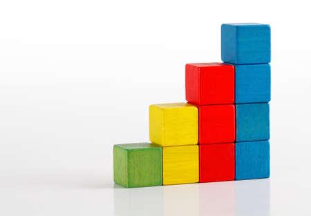 Photo pour Toys blocks as step stair, multicolor wooden ladder building bricks over white   - image libre de droit