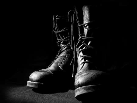 Foto de military army boots black background - Imagen libre de derechos