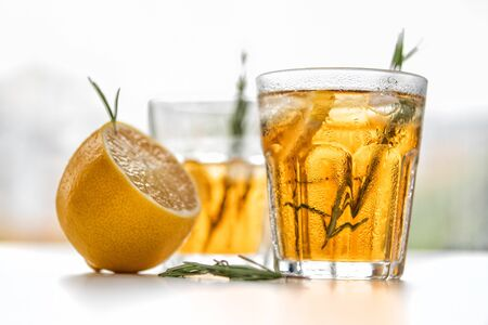 Photo pour glasses of soda with lemon and rosemary on a light background - image libre de droit