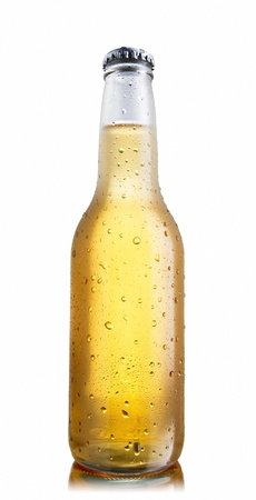 Non-glossy white beer bottle, back lighted showing a glowing golden beer content, drops and condensation, lower angle shoot