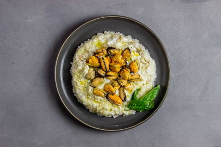Photo for Risotto with mussels . Italian cuisine. Proper nutrition. Vegetarian food - Royalty Free Image