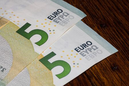 Photo for Detail on 5 euro banknote. Close up of banknote laid out on table. - Royalty Free Image