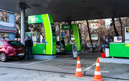 People filling their car tanks at MOL petrol gasoline station in Bucharest, Romania, 2020
