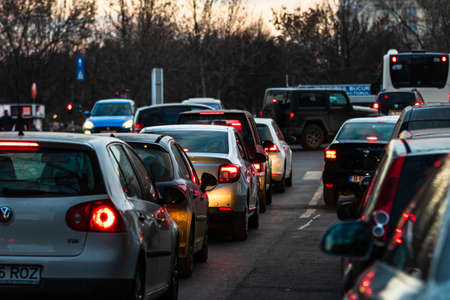 Photo pour Car traffic at rush hour in downtown area of the city. Car pollution, traffic jam in the morning and evening in the capital city of Bucharest, Romania, 2020 - image libre de droit