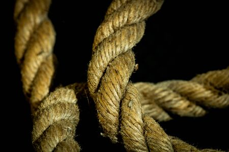 Photo pour Abstract composition, texture details of thick and strong rope isolated on blurred background, - image libre de droit