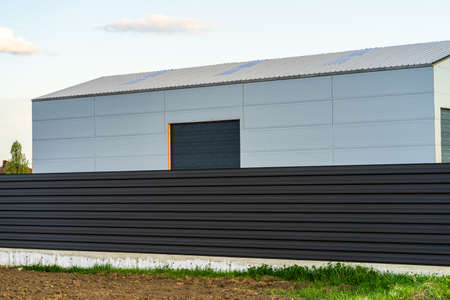 Photo for Big metal industrial storage shed building.  Exterior of warehouse, no brands on storehouse with copy space. - Royalty Free Image