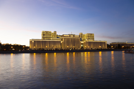 Main Building of the Ministry of Defence of the Russian Federation (Minoboron), at night-- is the governing body of the Russian Armed Forces and Moskva River. Moscow, Russia