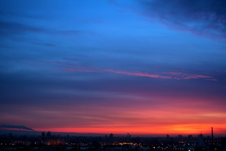 Dramatic evening cloudscape in city blue and red sky