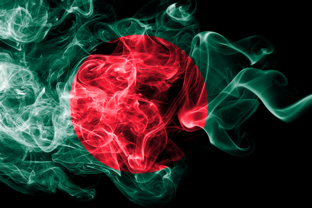 Photo pour National flag of Bangladesh made from colored smoke isolated on black background. Abstract silky wave background. - image libre de droit