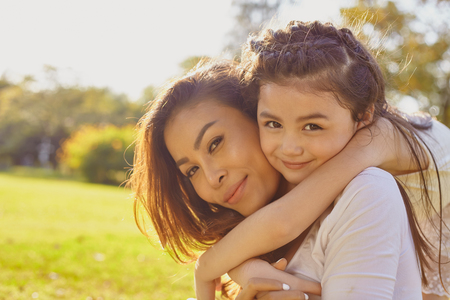 Photo pour Lifestyle portrait mom and daughter in happines at the outside in the meadow - image libre de droit