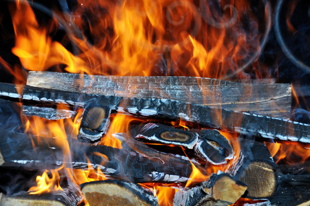The wood and the flames in the brazier as background