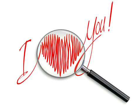 A declaration of love written in a red marker on a white background, in a magnifying glass.