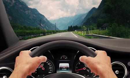 Foto de Driving hands steering wheel - Imagen libre de derechos