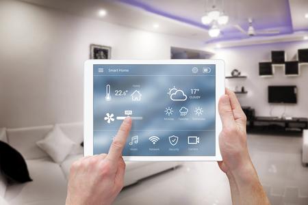 Photo pour Smart remote home control system app. Living room interior in background. - image libre de droit
