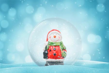 Photo pour Cute snowman in a glass magic ball. New Year decoration. Copy space beside. - image libre de droit