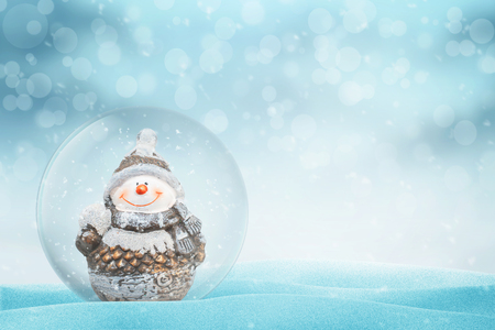 Photo pour New Year, Christmas magic ball with Snowman. Copy space beside. Light and bokeh in background. - image libre de droit