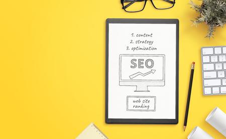 Foto de Search engine optimization goals sketch on paper. Office desk with copy space beside. Hero, header image. - Imagen libre de derechos