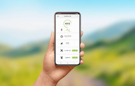 Photo for App for measuring mileage and calories burned concept. Modern smart phone in woman hand. Nature landscape in background. - Royalty Free Image